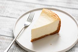 Slice Of Plain Cheesecake On White Plate
